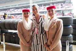 Emirates flight attendants pose with Miss Universe