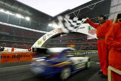 Sebastian Vettel crosses the line to win the Nations Cup