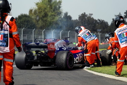 The car of race retiree Brendon Hartley, Scuderia Toro Rosso is recovered by Marshals after stopping on track with engine failure