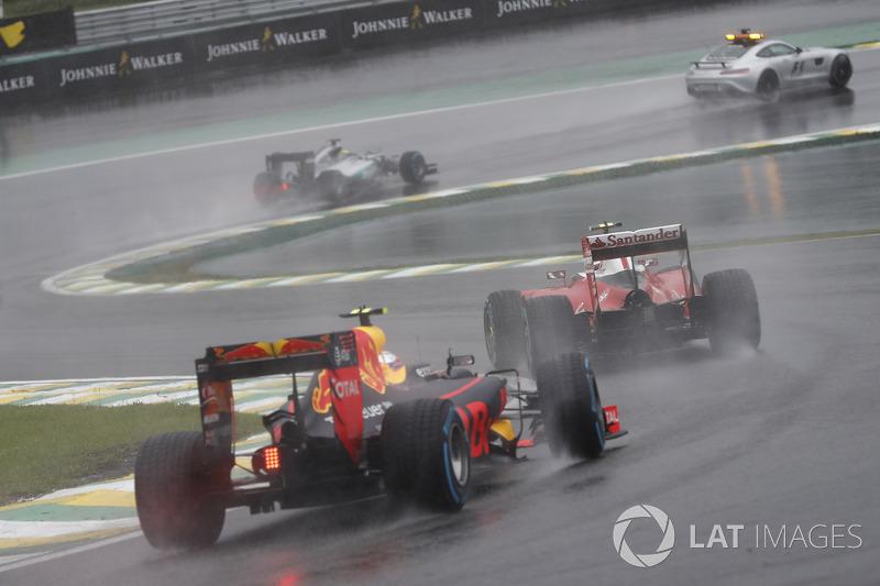 Kimi Raikkonen, Ferrari SF16-H, leads Max Verstappen, Red Bull Racing RB12