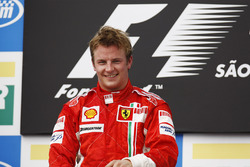 Kimi Raikkonen, Ferrari F2007, celebrates victory on the podium