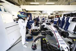 Felipe Massa, Williams FW40, prepares in the team's garage for FP3