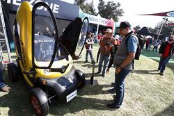 A fan checks out a Renault Sport F1 Team Twizzy