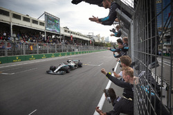 Lewis Hamilton, Mercedes AMG F1 W09, crosses the line for victory to the delight of his team