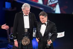 Nelson Piquet collects his Gregor Grant Award on stage with Gordon Murray