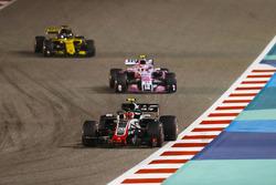 Kevin Magnussen, Haas F1 Team VF-18 Ferrari, leads Esteban Ocon, Force India VJM11 Mercedes, and Nico Hulkenberg, Renault Sport F1 Team R.S. 18