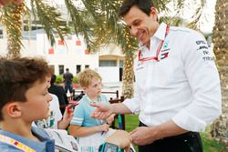Toto Wolff, Executive Director, Mercedes AMG, signs an autograph