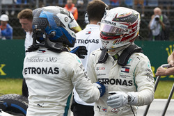 Valtteri Bottas, Mercedes AMG F1, and Lewis Hamilton, Mercedes AMG F1, congratulate each other on locking out the front row