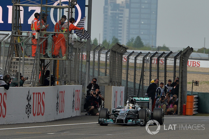 Race winner Lewis Hamilton, Mercedes AMG F1 W05 crosses the line to take the chequered flag