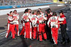 Crew members of race winner Matt Kenseth, Joe Gibbs Racing Toyota