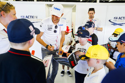 Esteban Ocon, Force India, signs autographs for the children
