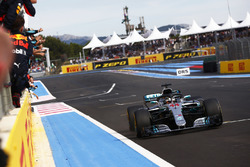 Lewis Hamilton, Mercedes AMG F1 W09, crosses the line to win the race