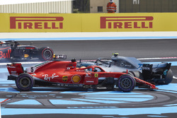 Sebastian Vettel, Ferrari SF71H, and Valtteri Bottas, Mercedes AMG F1 W09, spin to the back after contact on the opening lap