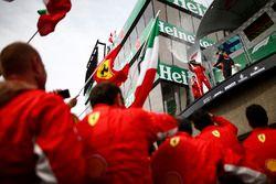 Sebastian Vettel, Ferrari, 1st position, and Max Verstappen, Red Bull Racing, 3rd position, spray Ch