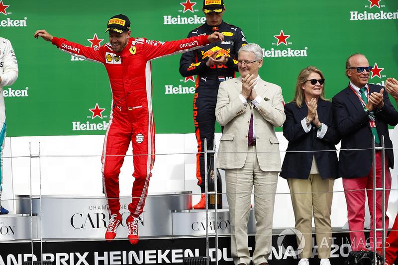 Sebastian Vettel, Ferrari, 1st position, leaps in celebration on the podium