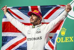 Race winner Lewis Hamilton, Mercedes AMG F1, with a Union flag on the podium