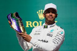 Usain Bolt presents Race winner Lewis Hamilton, Mercedes AMG F1, with a pair of his running shoes