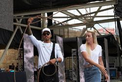 Lewis Hamilton, Mercedes AMG F1, is given a lesson on how to use a lasso, on the F1 stage