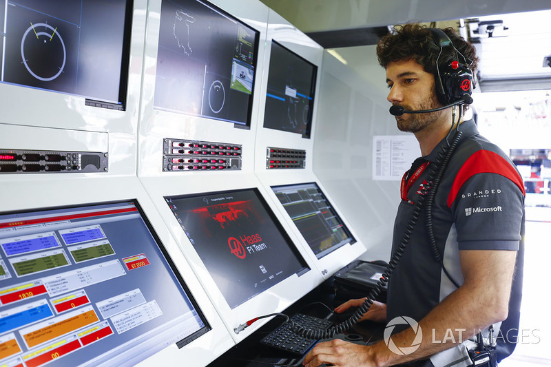 Haas F1 Team team member on the pit wall