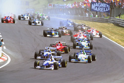 Jacques Villeneuve, Williams FW18 Renault leads Damon Hill, Williams FW18 Renault with Jean Alesi, Benetton B196 Renault