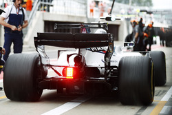 Lance Stroll, Williams FW40, spins his wheels exiting his pit box