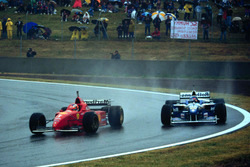Michael Schumacher, Ferrari F310 and Jacques Villeneuve, Williams FW18 Renault