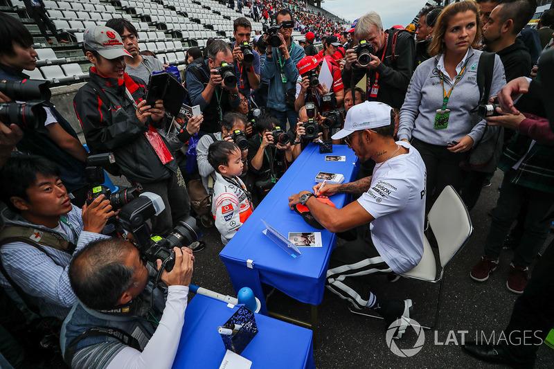 Lewis Hamilton, Mercedes AMG F1, signs autographs for the fans
