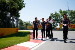 Kevin Magnussen, Haas F1 Team, conducts a track walk, colleagues