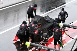 The car of Romain Grosjean, Haas F1 Team VF-17 is recovered after crashing