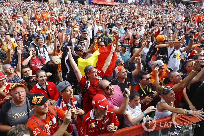 Fans gather around the stage in the F1 Fanzone