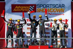 Podium: race winners Jordan Taylor, Ricky Taylor, Wayne Taylor Racing, second place Eric Curran, Dane Cameron, Action Express Racing, third place Joao Barbosa, Christian Fittipaldi, Action Express Racing