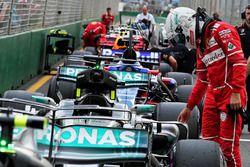 Sebastian Vettel, Ferrari looks at the Mercedes AMG F1 W08 in qualifying parc ferme