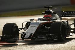 Esteban Ocon, Force India VJM10, lifts a wheel over a kerb