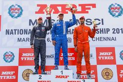 Race 1 podium: winner Karthik Tharani, second place Vikash Anand, third place Raghul Rangasamy