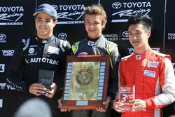 Podium: winner Lando Norris, second place Pedro Piquet, third place Guan Yu Zhou