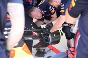 Red Bull Racing RB15 team members at work on the front brake drum