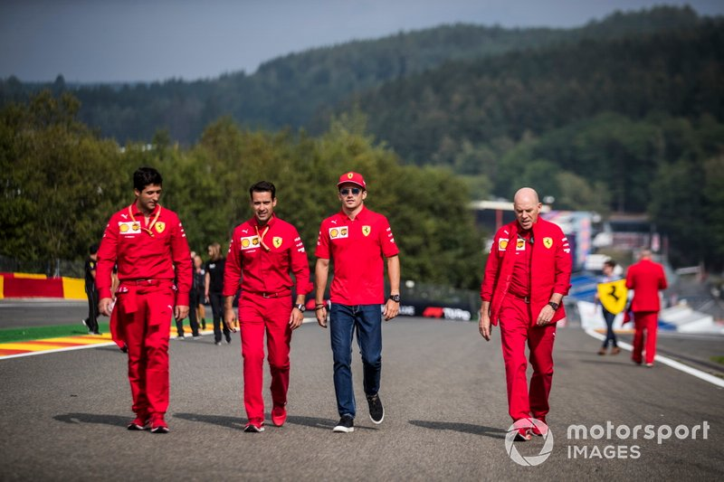 Charles Leclerc, Ferrari, walks the track with colleagues, including Jock Clear, Race Engineer, Ferrari.