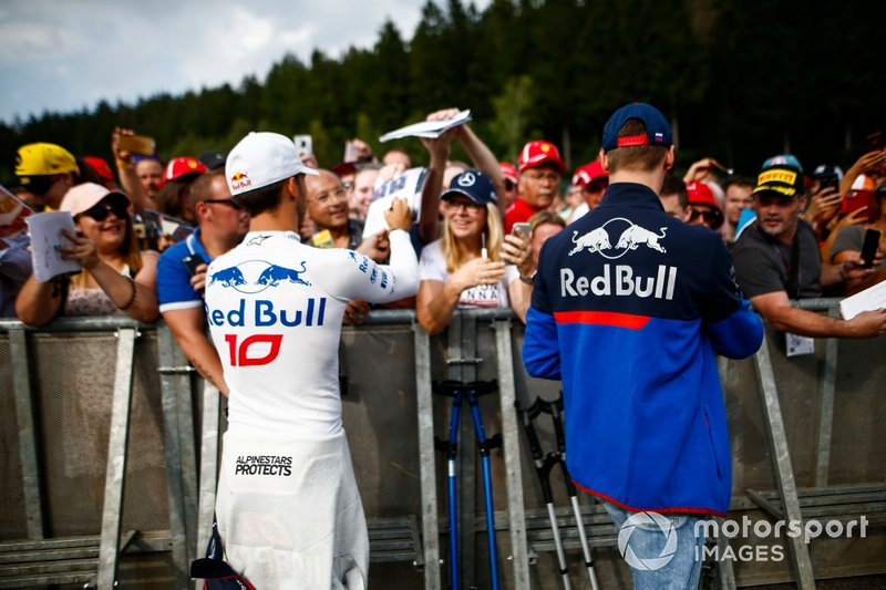 Pierre Gasly, Toro Rosso, and Daniil Kvyat, Toro Rosso sign autographs for fans