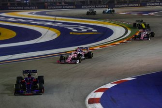 Daniil Kvyat, Toro Rosso STR14, leads Lance Stroll, Racing Point RP19, and Sergio Perez, Racing Point RP19