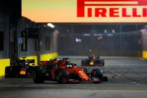 Sebastian Vettel, Ferrari SF90,leads Max Verstappen, Red Bull Racing RB15