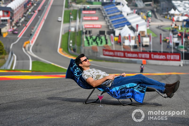 Steve Jones, Channel 4 presenter, relaxes on a sun-lounger at Eau Rouge
