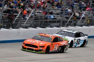 Clint Bowyer, Stewart-Haas Racing, Ford Mustang ITsavvy / Haas and J.J. Yeley, Rick Ware Racing, Chevrolet Camaro DriveSmart