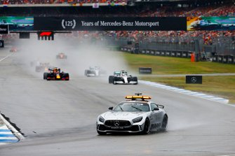 The Safety Car leads Lewis Hamilton, Mercedes AMG F1 W10, Max Verstappen, Red Bull Racing RB15, and the rest of the field