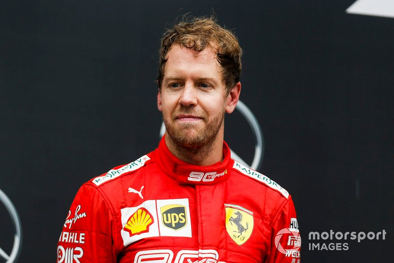 Sebastian Vettel, Ferrari, 2° classificato, sul podio