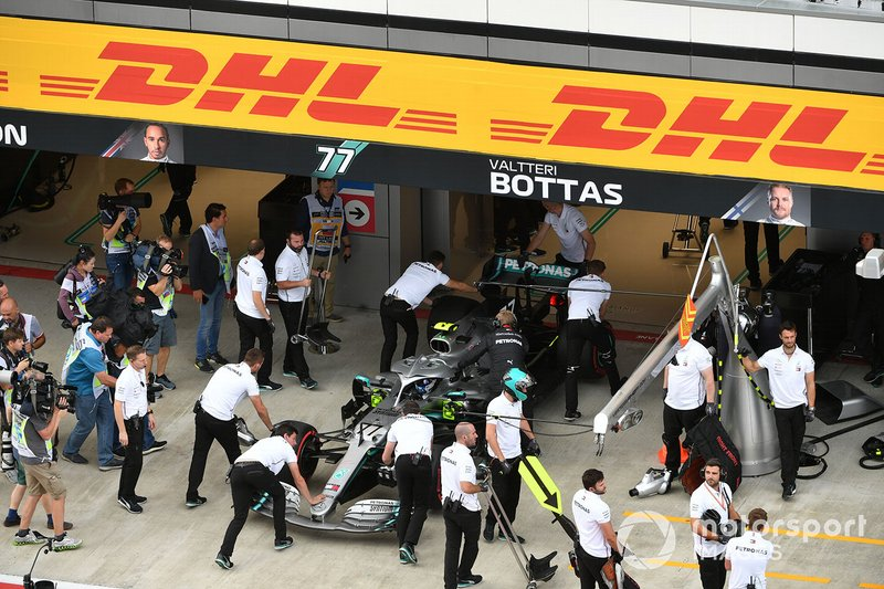 Valtteri Bottas, Mercedes AMG W10, is returned to the garage