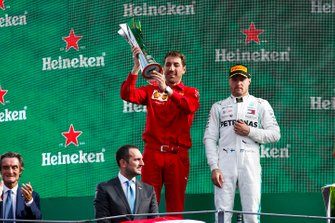 Matteo Togninalli, Head of Track Engineering, Ferrari , lifts the constructors trophy