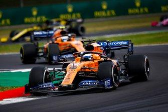 Carlos Sainz Jr., McLaren MCL34, leads Lando Norris, McLaren MCL34