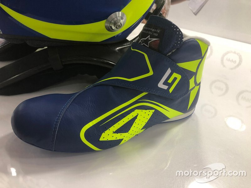 Boots of Lando Norris, McLaren with the colors of Valentino Rossi