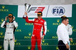 Leonardo Pulcini, Hitech Grand Prix, Race winner Marcus Armstrong, PREMA Racing and Jake Hughes, HWA RACELAB celebrate on the podium with the trophy