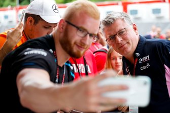 A fan takes a photo with Otmar Szafnauer, Team Principal and CEO, Racing Point